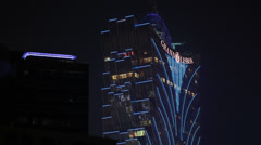 HD 1080p video of the Grand Lisboa Casino hotel in Macau Stock Footage