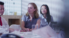 Young mixed ethnicity business team brainstorming in a boardroom meeting - stock footage
