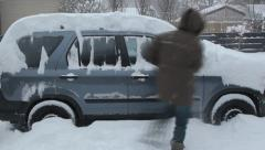 Clearing snow from SUV. Timelapse. Stock Footage