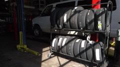 White minivan behind the tires - stock footage