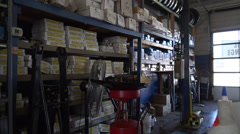 Slider shot of auto repair shop shelves Stock Footage