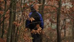 Stock Video Footage of man walking in the forest