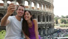 Tourist couple on travel in Rome by Coliseum Stock Footage