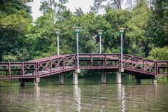 Wooden bridge over pond Stock Photos
