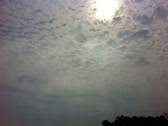 Stock Video Footage of Sky And Clouds With Sun Ray Of Light From Rusty Window - Timelapse
