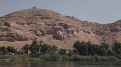 Camera boat - Nile shores, palms and mountains, Egypt Stock Footage