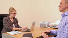 Doctor and patient consultation in Doctors surgerynt - stock footage