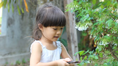 Happy girl playing at garden - stock footage