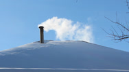 Stock Video Footage of house roof with snow and white smoke from the chimney, air pollution