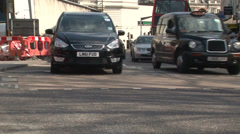 London traffic junction - cars drive past Stock Footage