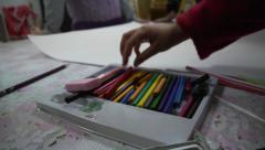 Children at school - drawing in pastel - stock footage