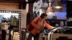 Customers in the fashion store. Stock Footage