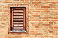 Stock Photo of italian style wooden window with closed shutter blinds