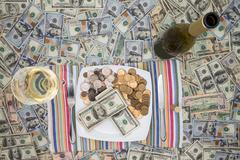 Eating money through greed and extravagance Stock Photos