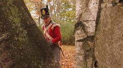 British Soldier jabs his bayonet through tree Stock Footage