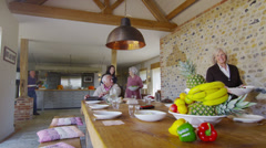 Happy extended family group sit down to enjoy a meal together at home Stock Footage
