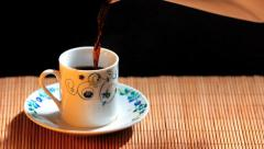 Cup of coffee - Pouring coffee into cup Stock Footage