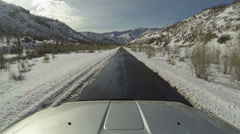 Driving truck winter mountain canyon road POV fast HD Stock Footage