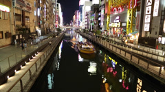 Cruise boat on the river in Dotonbori Stock Footage