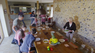 Stock Video Footage of Happy extended family group sit down to enjoy a meal together at home