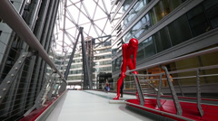 Sculpture of red man Stock Footage