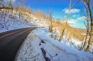Stock Photo of winter landscape wraps around the road