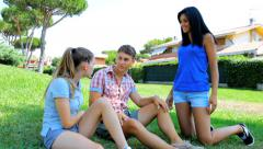 Two jealous women hitting young man Stock Footage