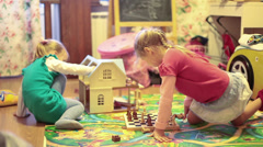Children playing chess in playroom on the floor - stock footage