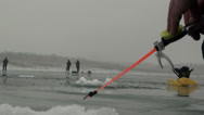 Stock Video Footage of Fishing rod on the river in winter on ice near hole