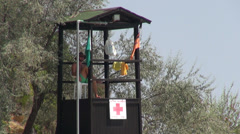 Lifeguard tower on beach, first aid, lifeguard on duty, red cross - stock footage
