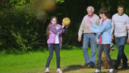 Stock Video Footage of Happy extended family group walking in the countryside on an autumn day