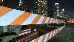 Time Lapse Through Construction Barrier Reveals Downtown LA - stock footage