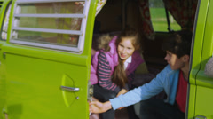 Happy family getting into camper van and going on holiday Stock Footage