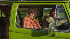 Happy family getting into camper van and going on holiday - stock footage