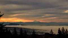 Sun light shining through clouds on to fog below - stock footage