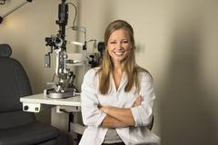 Female eye doctor in examintaion room Stock Photos