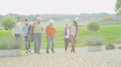 Affectionate extended family group take a walk together outdoors in autumn - stock footage