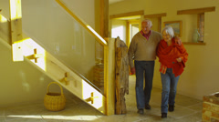 Cheerful senior couple pay a visit to their family at home Stock Footage