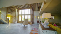 Interior view of living area in stylish country home with lots of natural light - stock footage