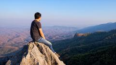 man on rock at mountain - stock photo