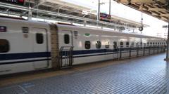 Japanese Shinkansen bullet train passing through a station Stock Footage