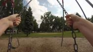 Stock Video Footage of Swinging in a park