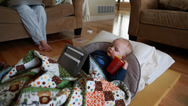 Stock Video Footage of toddler sick with the flu and mother watching a tablet