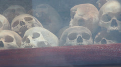 Tilt down and pan skulls on display in Killing Fields memorial in Cambodia Stock Footage