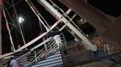 Ferris Wheels Runs as Couple Waits To Ride Stock Footage