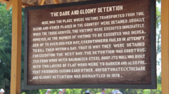 Stock Video Footage of Quick zoom out to 'gloomy detention' sign at Killing Fields memorial, Cambodia