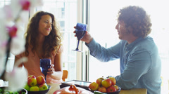Couple relaxing together at home with a glass of wine Stock Footage