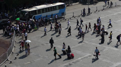 Chinese travellers in front of train station Stock Footage