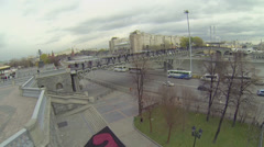 People walk by Patriarshy bridge against cityscape Stock Footage