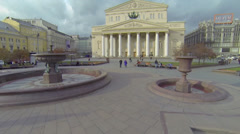 Citizens walk by square near edifice of Bolshoy Theater - stock footage